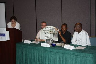 From left, moderator Judith Mandelbaum Schmid with award-winners Carlos Fioravanti, Charles Mpaka and Neway Tsegaye leading a journalism discussion with National Press Foundation fellows in Cancun.